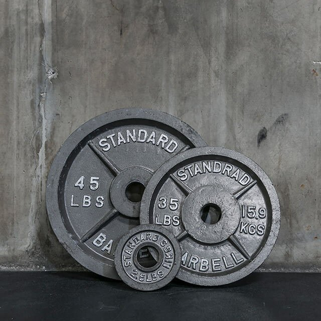 Photograph of three iron weights against wall
