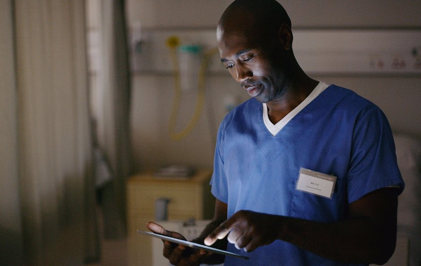 Shot of a medical practitioner using a digital tablet to view a medical chart