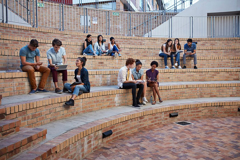 Students studying in groups outdoors on campus